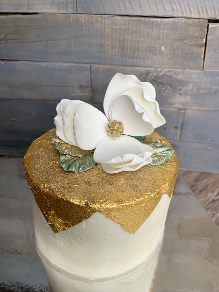 Golf Leaf Cake with an orchid